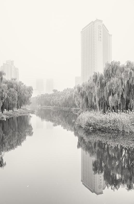 Haze of Beijing's smog over the Landmark River, Sanlitun, Beijing, China.