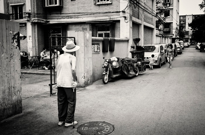 Elderly man wearing vest and panama hat in  Xiaoguan, Chaoyang, Beijing, China.