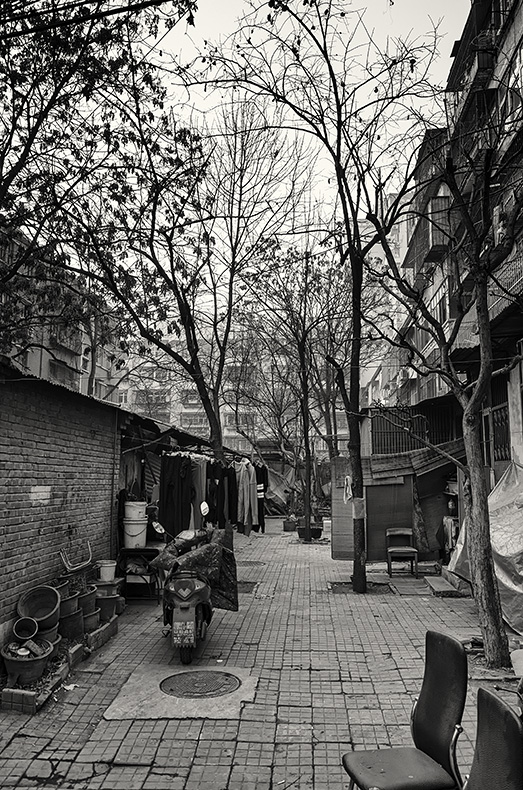 The yard to an apartment block off Sanfeng S Alley, Russia Town, Beijing, China.