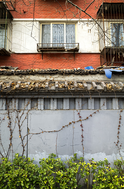 Layers and textures of an apartment block on Baiwanzhuang Street, Xicheng, Beijing, China.