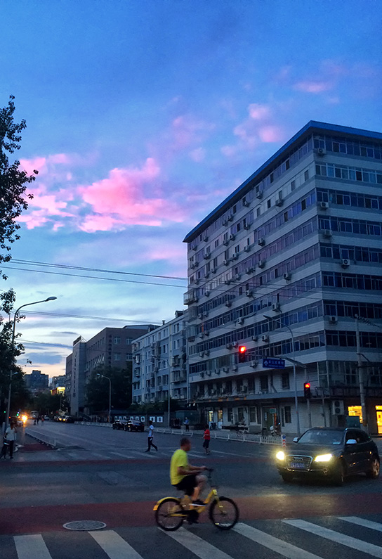 Pink clouds over Chegongzhuang S Street as the sun sets, Xicheng, Beijing, China.